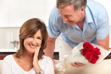 Man giving his happy wife roses