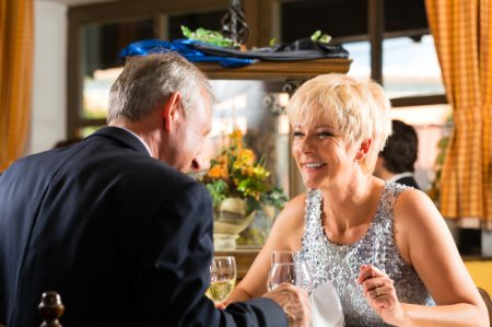 Senior couple fine dining in restaurant